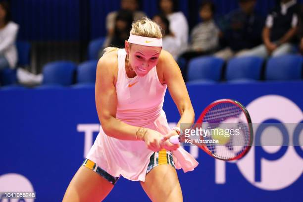 Donna Vekic of Croatia plays a backhand against Johanna Konta of Great Britain in her Singles Round of 16 match on day four of the Toray Pan Pacific...