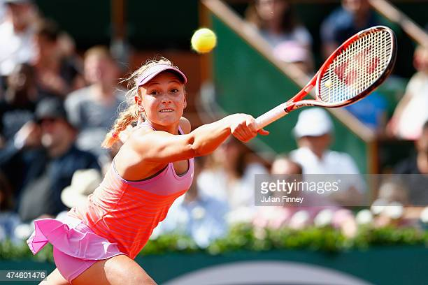 Donna Vekic of Croatia plays a backhand in her Women's Singles match against Caroline Garcia of France on day one of the 2015 French Open at Roland...