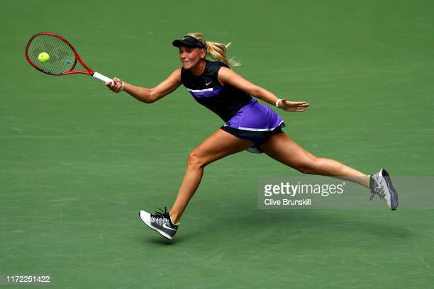 Donna Vekic of Croatia returns a shot during her Women's Singles quarterfinal match against Belinda Bencic of Switzerland on day ten of the 2019 US...