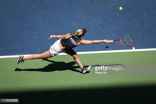 Donna Vekic of Croatia returns a shot during the match against Ons Jabeur of Turkey on Day 2 of 2019 Dongfeng Motor Wuhan Open at Optics Valley...