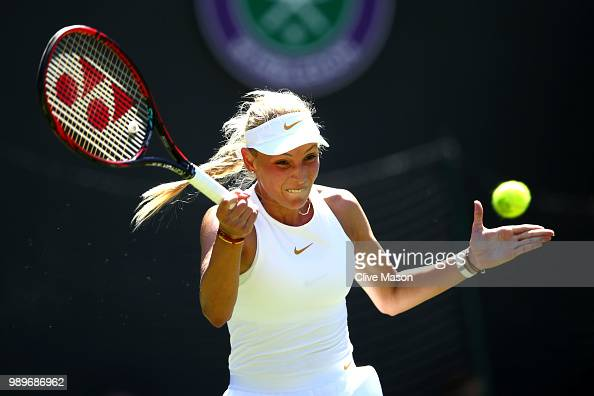 Donna Vekic of Croatia returns to Sloane Stephens of The United States during their Ladies' Singles first round match on day one of the Wimbledon...