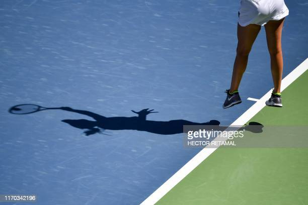 TOPSHOT Donna Vekic of Croatia serves against Ons Jabeur of Tunisia during their first round women's singles match at the Wuhan Open tennis...
