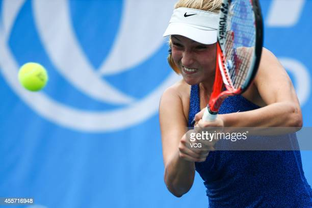 Donna Vekic of Croatia serves in the qualifying match against Ajla Tomljanovic of Australia prior to the start of 2014 WTA Wuhan Open at Optical...