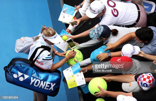 Donna Vekic of Croatia signs autographs for fans after winning her Women's Singles second round match against Alize Cornet of France on day four of...