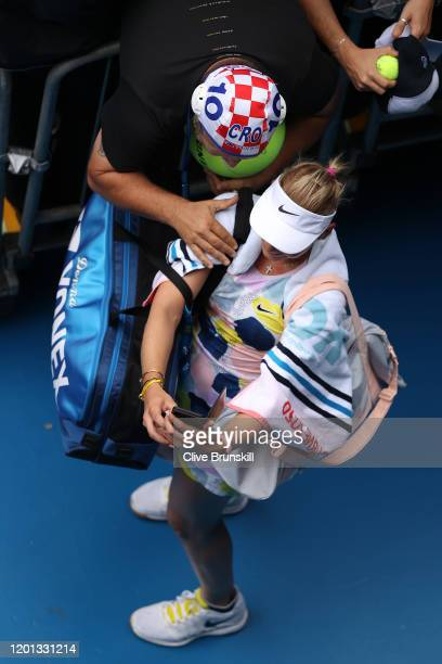 Donna Vekic of Croatia takes a selfie with a fan after winning her Women's Singles second round match against Alize Cornet of France on day four of...