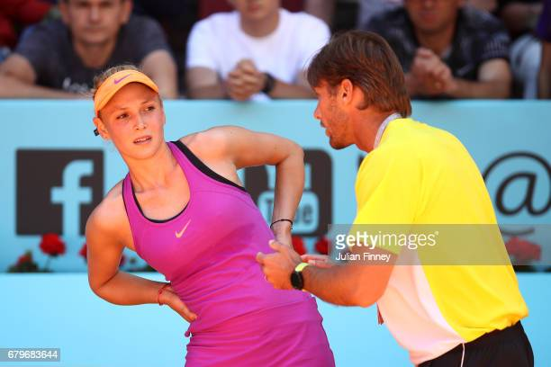Donna Vekic of Croatia with coach as she plays Shelby Rogers of USA during day one of the Mutua Madrid Open tennis at La Caja Magica on May 6 2017 in...