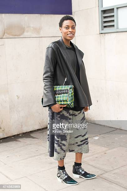 Donna Wallace Accessories Editor at Elle Magazine wears a Jospeh sweatshirt Whistles shorts Toga boots All Saints leather jacket and a Marni Clutch...