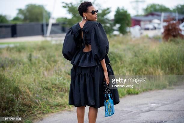 Donna Wallace is seen wearing black dress outside Cecilie Bahnsen during Copenhagen Fashion Week Spring/Summer 2020 on August 07, 2019 in Copenhagen,...