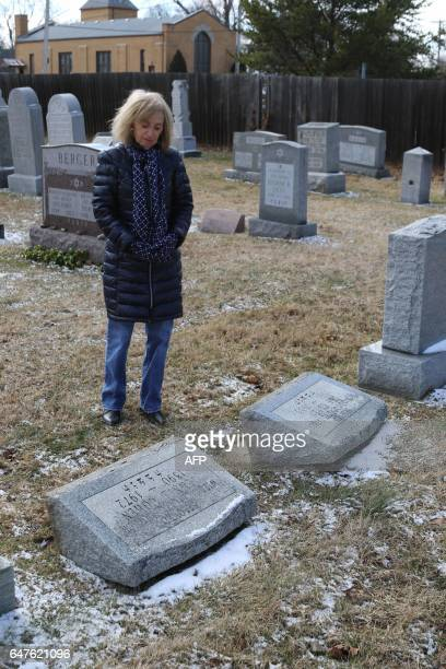 Donna Zack looks at vandalized gravestones at Stone Road or Waad Hakolel Cemetery in Rochester New York on March 3 2017 Vandals tumbled and defaced...