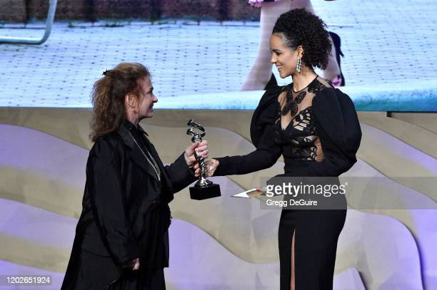Donna Zakowska accepts the Excellence in Period Television award for 'The Marvelous Mrs Maisel' from Nathalie Emmanuel onstage during the 22nd CDGA...