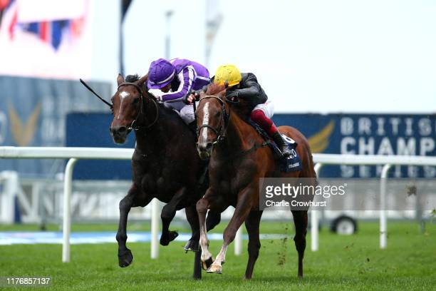 Donnacha O'Brien rides Kew Gardens to beat Frankie Dettori on Stradivarius in The QIPCO British Champions Long Distance Cup during the QIPCO British...