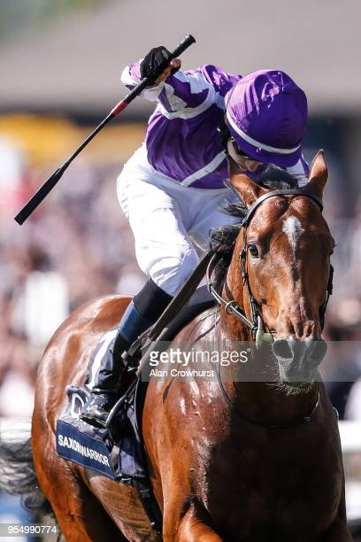 Donnacha O'Brien riding Saxon Warrior celebrates as they win The Qipco 2000 Guineas Stakes at Newmarket Racecourse on May 5 2018 in Newmarket United...