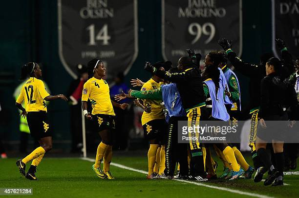DonnaKay Henry of Jamaica celebrates after scoring a goal in the first half of a game against Mexico during the 2014 CONCACAF Women's Championship at...