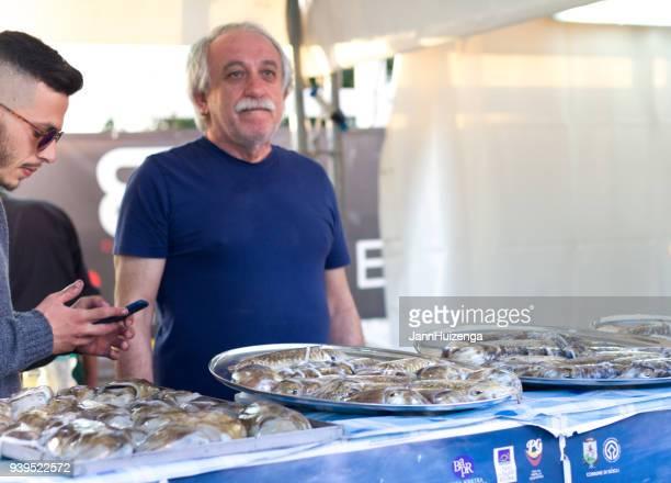 Donnalucata, Sicily: Men Sell Cuttlefish at St Joseph Festival