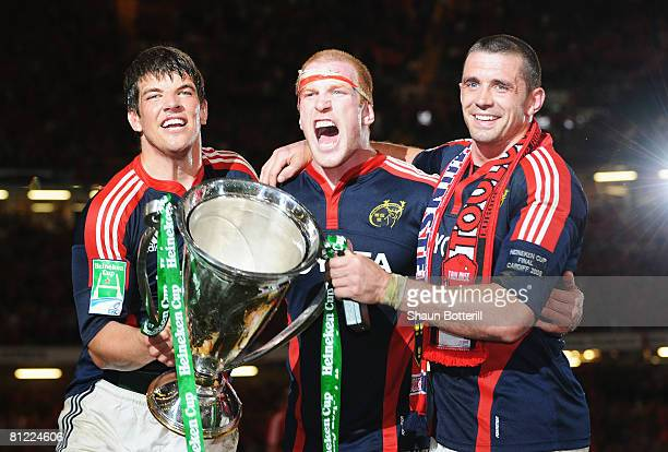 Donncha O'Callaghan, Paul O'Connell and Alan Quinlan of Munster celebrate with the trophy following victory in the Heineken Cup Final between Munster...