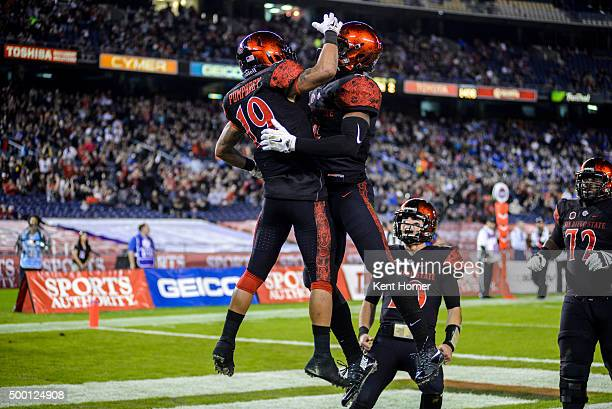 Donnel Pumphrey of the San Diego State Aztecs celebrates with Jemond Hazely after scoring a touchdown in the first half of the Mountain West...