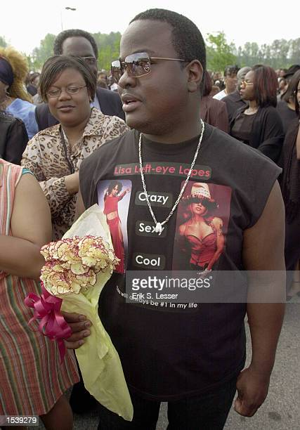 Donnell Gilbert wears a homemade Tshirt while waiting in line to attend the public funeral of singer Lisa Left Eye Lopes at the New Birth Missionary...