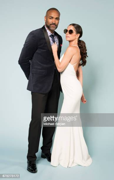 Donnell Turner and Kelly Monaco pose with Foster Grant Sunglasses at Portraits by The Artists Project Sponsored by Foster Grant on during the 44th...
