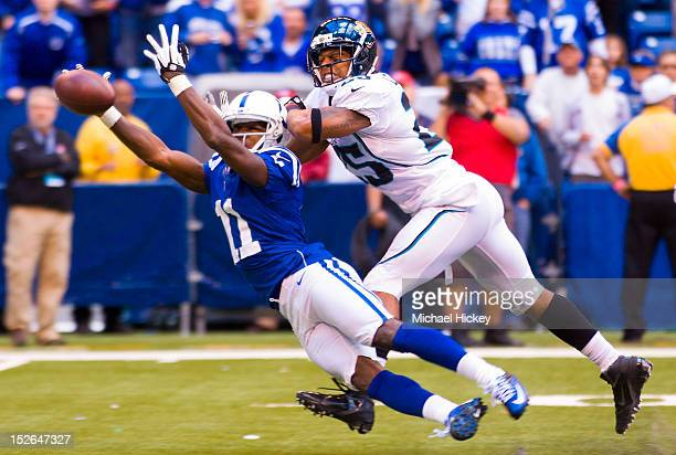Donnie Avery of the Indianapolis Colts reaches out for a catch that fell incomplete as Dwight Lowery of the Jacksonville Jaguars defends at Lucas Oil...