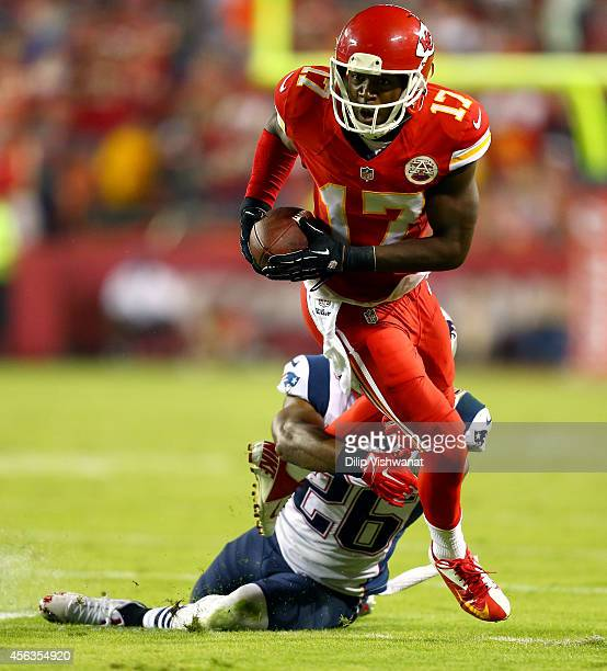 Donnie Avery of the Kansas City Chiefs runs the ball against Logan Ryan of the New England Patriots during the first half at Arrowhead Stadium on...