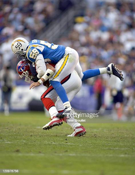 Donnie Edwards linebacker for the San Diego Chargers sacks JP Losman in a game against the Buffalo Bills at Qualcomm Stadium in San Diego California...