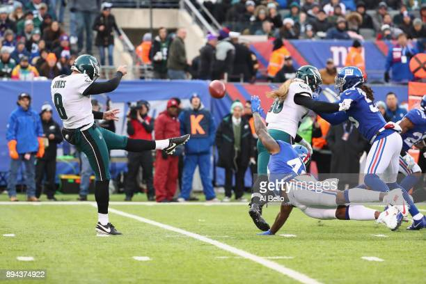 Donnie Jones of the Philadelphia Eagles kicks a punts the ball against the New York Giants during the fourth quarter in the game at MetLife Stadium...
