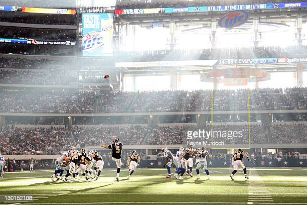 Donnie Jones of the St Louis Rams punts into the sun against the Dallas Cowboys at Cowboys Stadium on October 23 2011 in Arlington Texas