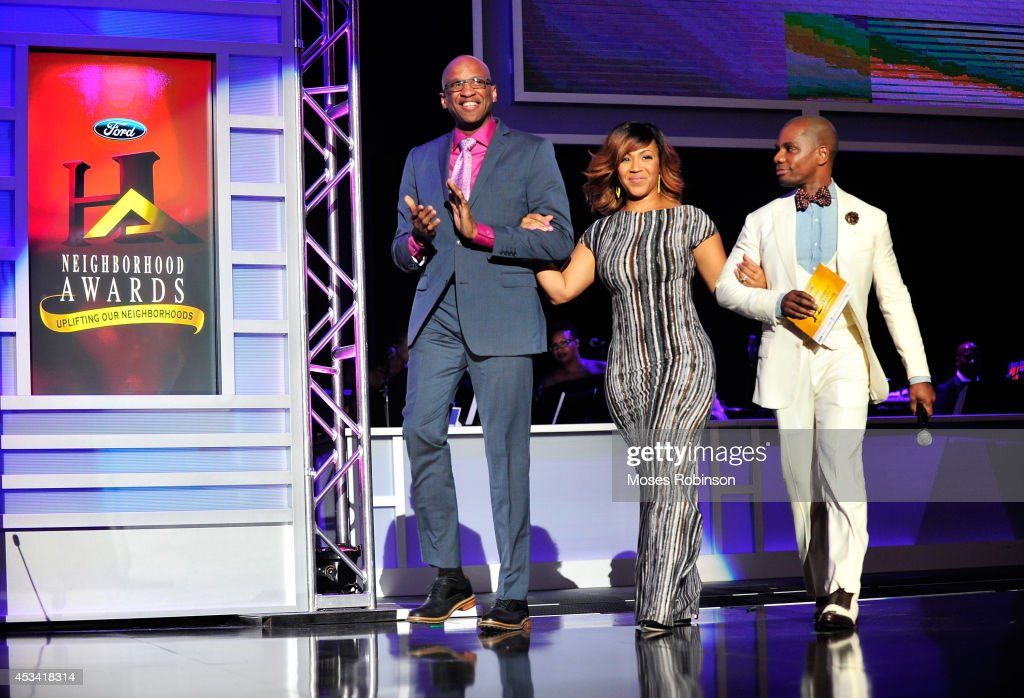 Donnie McClurkin, Erica Campbell and Kirk Franklin present onstage at the 2014 Ford Neighborhood Awards Hosted By Steve Harvey at the Phillips Arena on August 9, 2014 in Atlanta, Georgia.