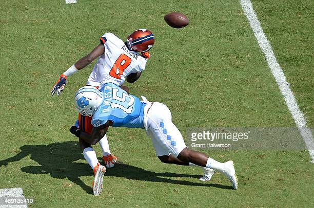 Donnie Miles of the North Carolina Tar Heels breaks up a pass intended for Geronimo Allison of the Illinois Fighting Illini during their game at...