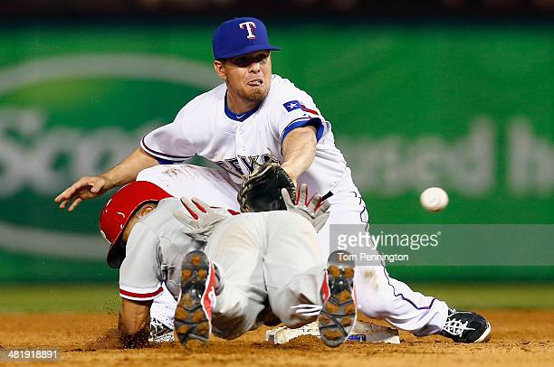 Donnie Murphy of the Texas Rangers tags out Ben Revere of the Philadelphia Phillies at second base in the top of the sixth inning at Globe Life Park...