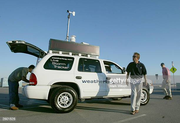 Donnie Reed Richard Reed and Jan Dutton of WeatherBugcom work out of their vehicle while tracking and giving updates on Hurricane Isabel September 16...