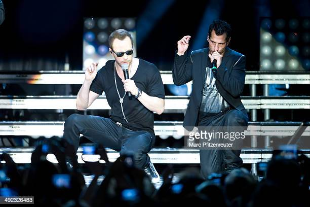 Donnie Wahlberg and Danny Wood of American Boygroup New Kids On The Block perform during their 'Let's get Intimate Tour 2014' at the Palladium on May...