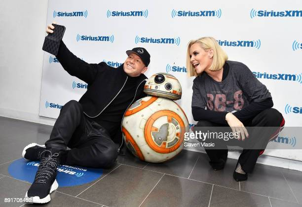Donnie Wahlberg and Jenny McCarthy pose with Star Wars characterAstromech Droid BB8 at SiriusXM Studios on December 13 2017 in New York City