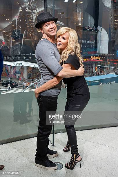 "Donnie Wahlberg and Jenny McCarthy visit ""Extra"" at their New York studios at H&M in Times Square on June 15, 2015 in New York City."