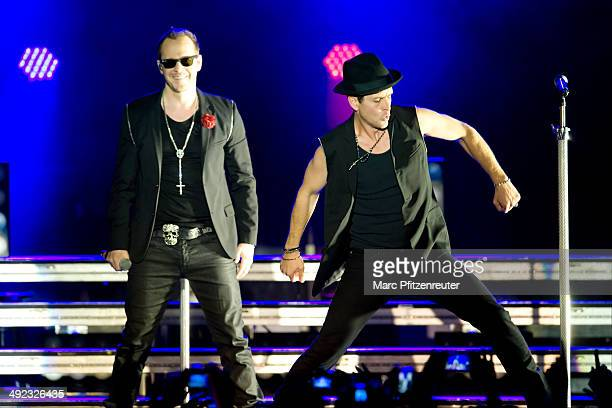 Donnie Wahlberg and Joey McIntyre of American Boygroup New Kids On The Block perform during their 'Let's get Intimate Tour 2014' at the Palladium on...