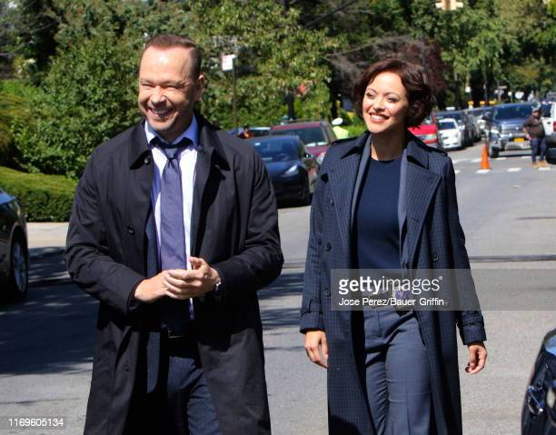 """Donnie Wahlberg and Marisa Ramirez are seen on the set of """"Blue Bloods"""" on September 19, 2019 in New York City."""
