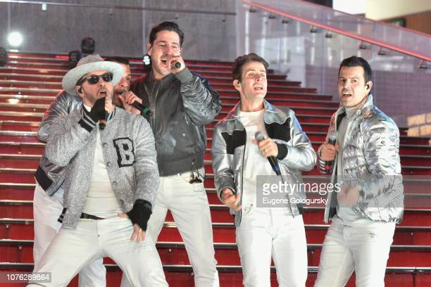 Donnie Wahlberg Danny Wood Jonathan Knight Joey McIntyre and Jordan Knight of New Kids on the Block perform on stage during Dick Clark's New Year's...