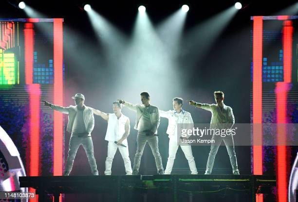 Donnie Wahlberg Danny Wood Jordan Knight Jonathan Knight and Joey McIntyre of the musical group New Kids On The Block perform at Bridgestone Arena on...