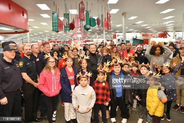 Donnie Wahlberg helps Target celebrate 10 years of its Heroes & Helpers program in Edgewater, N.J. This holiday season, Target will host nearly 400...