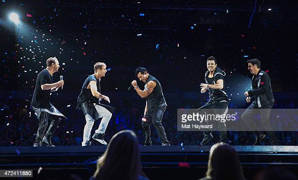 Donnie Wahlberg Jordan Knight Danny Wood Joey McIntyre and Jonathan Knight of New Kids On The Block perform on stage at Tacoma Dome on May 6 2015 in...