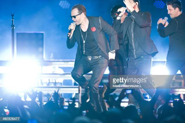 Donnie Wahlberg Jordan Knight Jonathan Knight and Joey McIntyre of American Boygroup New Kids On The Block perform during their 'Let's get Intimate...