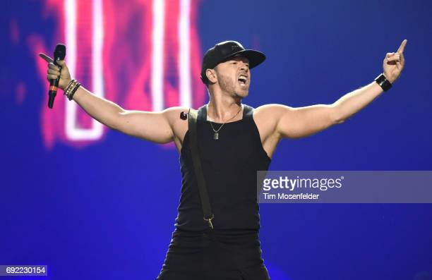 """Donnie Wahlberg of New Kids on the Block performs during """"The Total Package Tour"""" at Golden 1 Center on June 3, 2017 in Sacramento, California."""