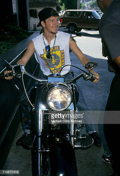 Donnie Wahlberg of New Kids On The Block riding a motorcycle circa 1990