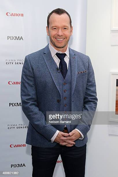 Donnie Wahlberg reveals his photographs printed on the Canon PIXMA PRO printers at the Canon PIXMA PRO City Senses Gallery at EpiCenter in Boston on...