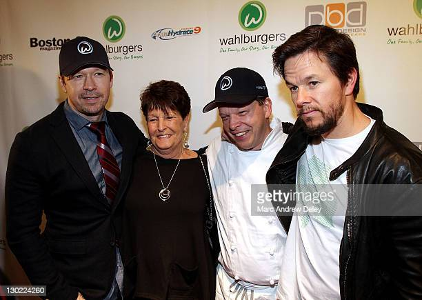 Donnie Wahlberg their mother Alma Elaine Wahlberg chef Paul Wahlberg and Mark Wahlberg attend the grand opening of Wahlburgers on October 24 2011 at...