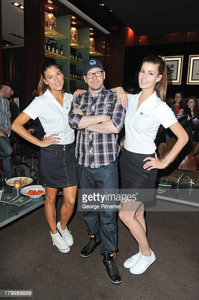 Donnie Wahlberg with Wahlbugers girls at Wahlburgers burger bash at Soho Metropolitan Hotel on September 7 2013 in Toronto Canada