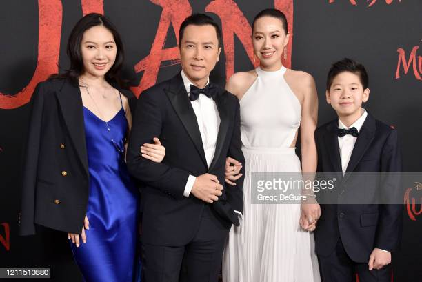 "Donnie Yen, wife Cissy Wang, children Jasmine Yen and James Yen attend the Premiere Of Disney's ""Mulan"" on March 09, 2020 in Hollywood, California."