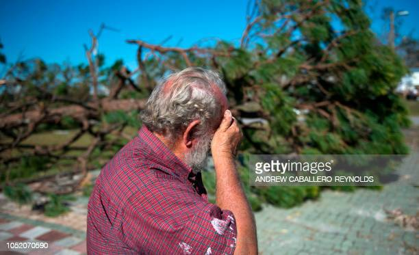 Donnie Young reacts after seeing one of his houses in Port St Joe beach Florida on October 13 three days after hurricane Michael hit the area Since...