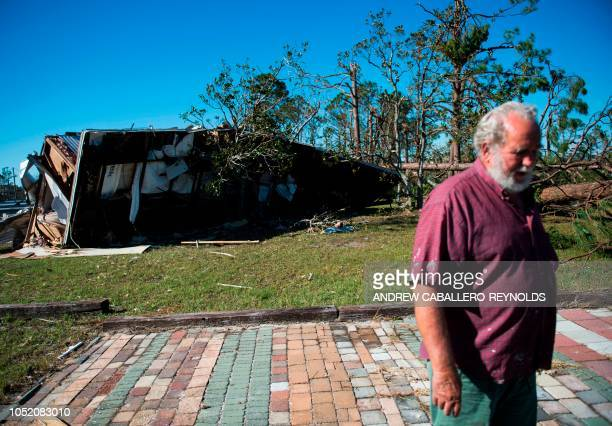 Donnie Young surveys damage to his property in Port St Joe beach Florida on October 13 three days after hurricane Michael hit the area Since...