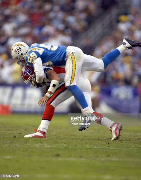 Donnis Edwards linebacker for the San Diego Chargers sacks JP Losman in a game against the Buffalo Bills at Qualcomm Stadium in San Diego California...